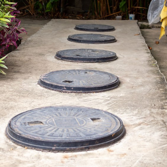 septic tank lids in a row