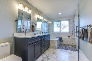 A Remodeled Bathroom With Excellent Lighting